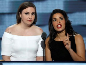 Actresses Lena Dunham and America Ferrera (R) speak on stage at the Democratic National Convention in Philadelphia, Pennsylvania, U.S. July 26, 2016. REUTERS/Mike Segar - RTSJT25